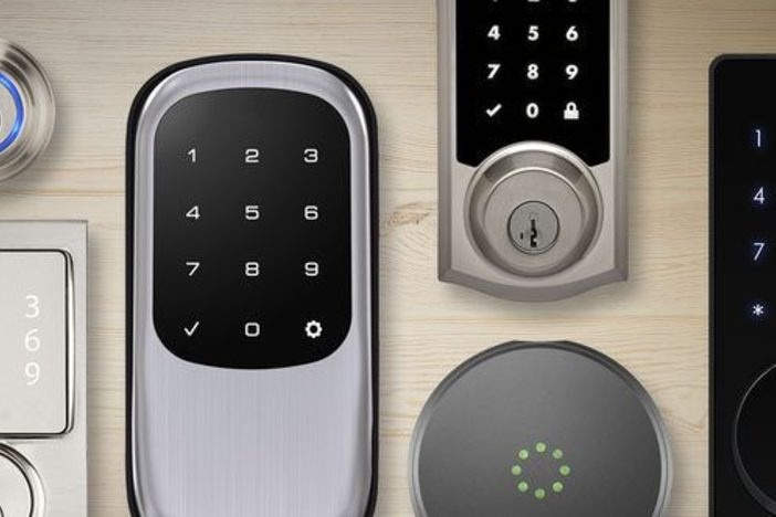 variety of smart locks side by side on a light background