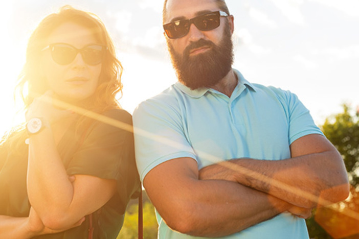 Middle-aged people wearing sunglasses. A man and a woman together. Happy adult couple.