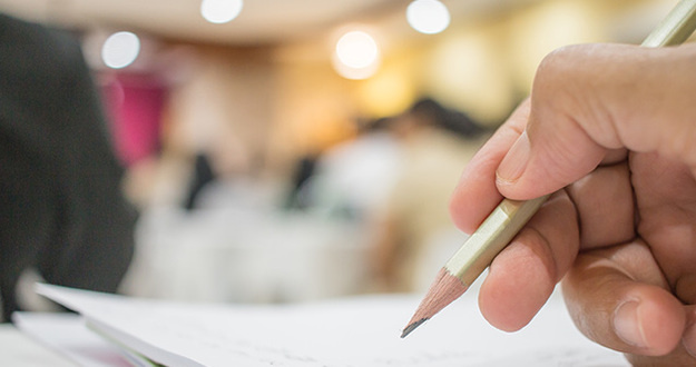 Business people making and writing notes at conference seminar with blur light business peple background.Seminar is form of academic instruction, offered by a commercial or professional organization