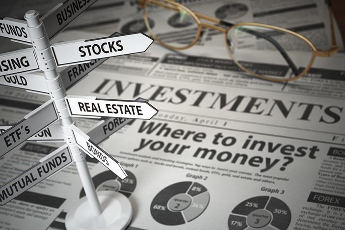 Investmments and asset allocation concept. Where to Invest? Newspaper and direction sign with investment options