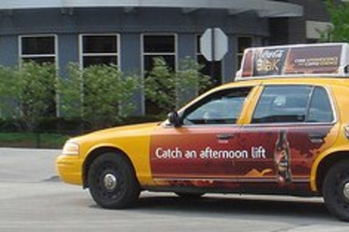 taxi advertising real estate
