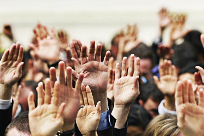 hands-raised-investors