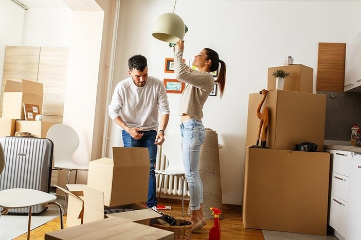 Young couple cleaning and selecting things at they new home.Movi