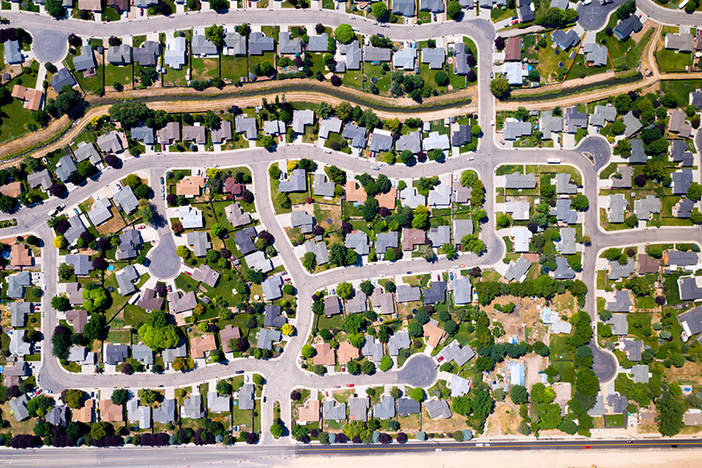 aerial view of houses and culdesacs and tree-lined streets